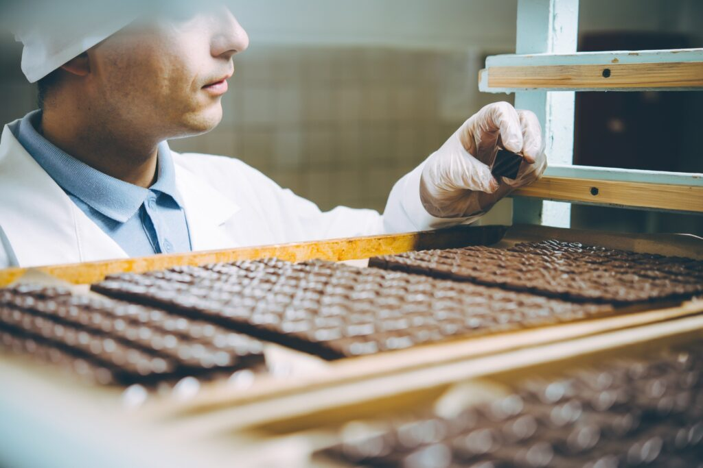 Chocolate factory worker makes sure food is up to SQF code